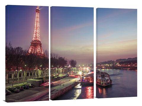 Eiffel tower across the river Siene at dusk