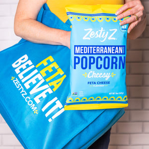 Load image into Gallery viewer, Zesty Z customer holding feta mediterranean popcorn