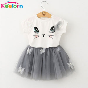 girl's t-shirt and tulle skirt outfit. cat face. white and grey