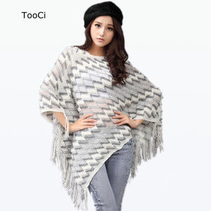 poncho with tassels. white and grey