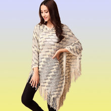 poncho with tassels. beige