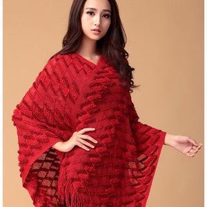 poncho with tassels. red
