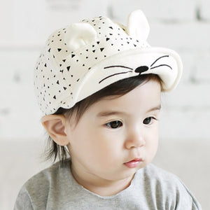 Baseball cap style cat cap for infants and toddlers. Adjustable. White.