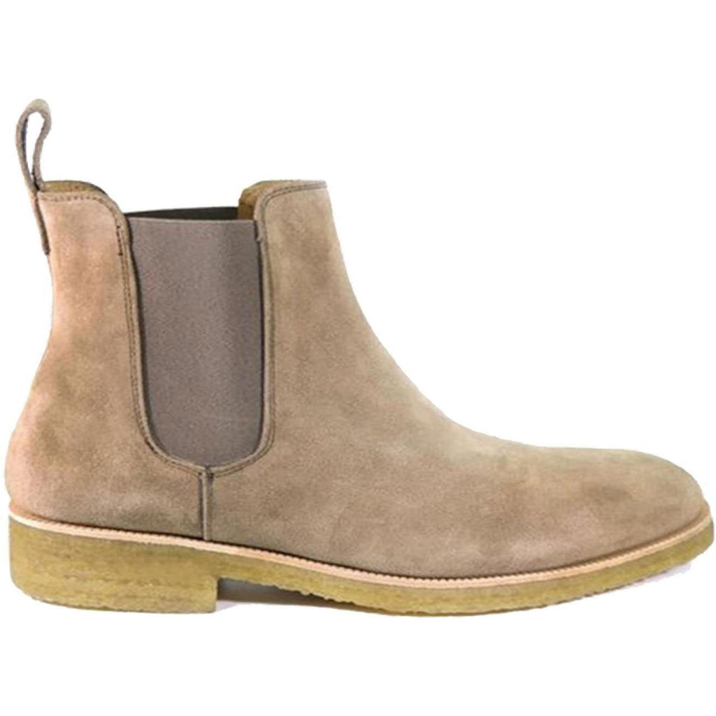 Light tan chelsea boot side view with crepe sole and elestic band sides