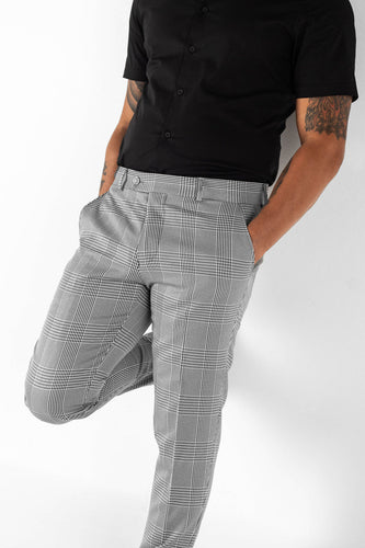 Black and white plaid patterned trousers/pants