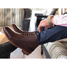 mens leather dark brown boots handmade from Spain with navy blue pants