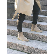 tan chelsea style boot with black pants