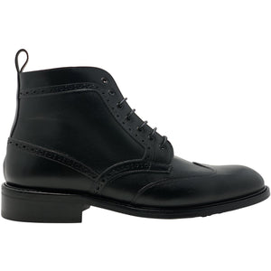 Side view winged leather boot in black The Cruz Boot in Black
