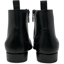 Double back side view; black chelsea leather boot