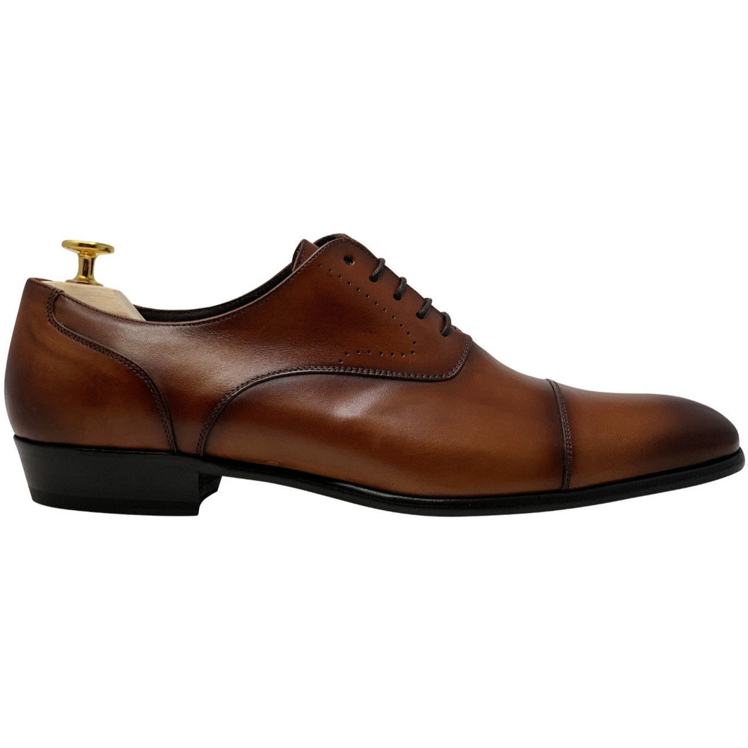 brown shoes with brogue design caramel or cognac side view