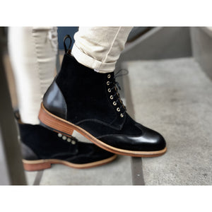 black Boot with leather wing tip and natural leather sole with rubber taps