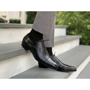 Mens handmade leather shoe in black with gray pants