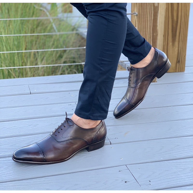 Mens dark brown leather shoes from Spain with navy blue pants