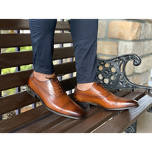Mens brown leather shoes, brogue design, no medallion with navy pants