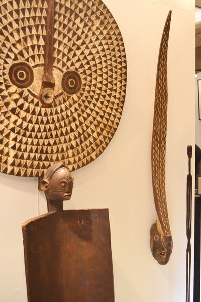 On the left, On display at the Harlem Fine Arts Show in NYC: Authentic Mask from Burkina Faso Made in 1963