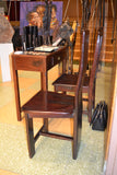 Profile view, on display at the Harlem Fine Arts Show in NYC: Antique Hand Made Red Jarrah Wood Chair from Zimbabwe