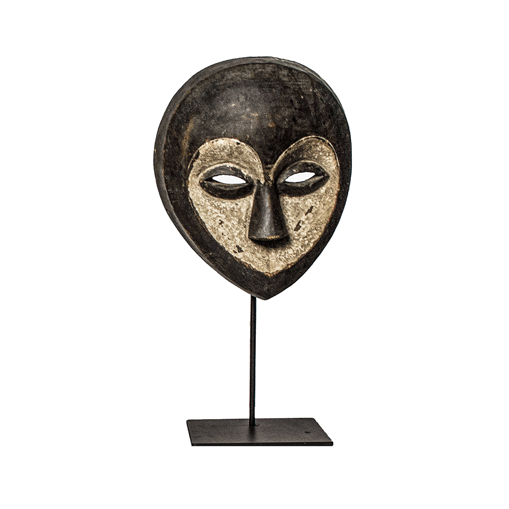 One of a kind African Fine Art: Authentic 'Kwele Mask' from Cameroon Made in 1968. This lightweight mask can be easily mounted to the wall or mounted on a custom made mask stand that is included with your purchase.