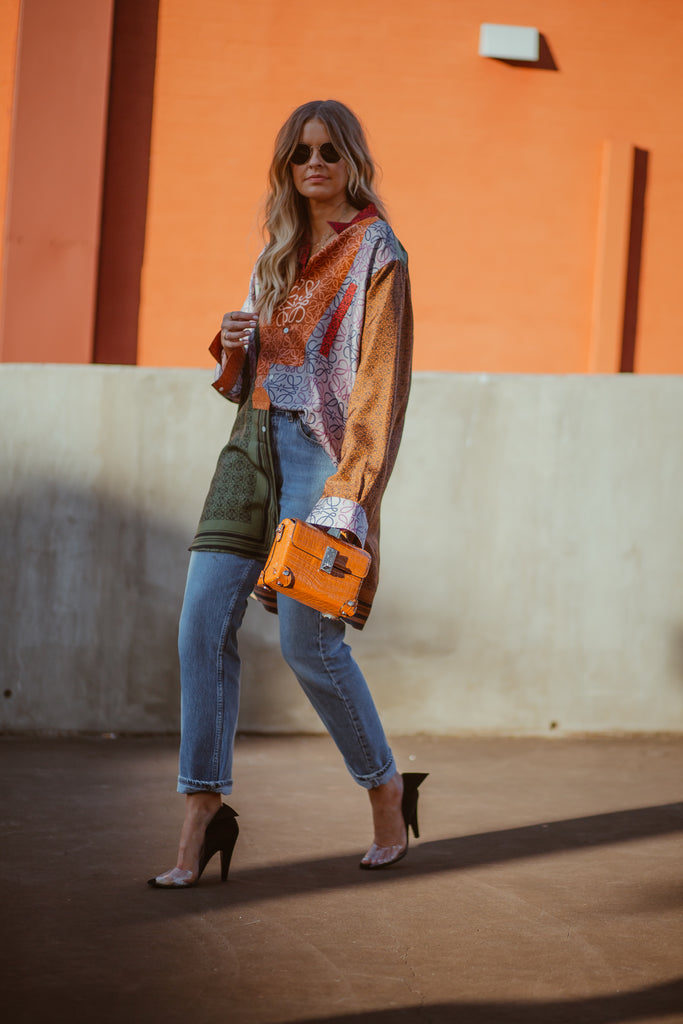 how to elevate your style: tucked printed top and jeans with heels street style