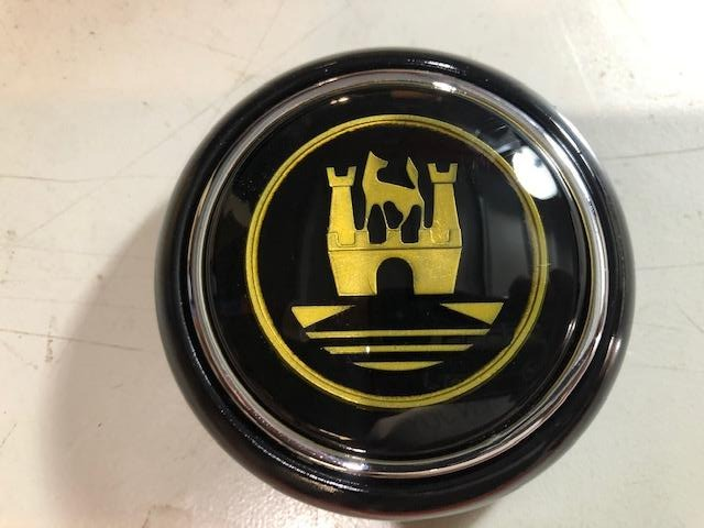 Split Screen Black Horn Button with Gold crest