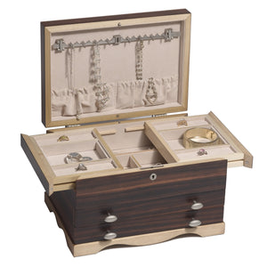 "Beneath the sliders are two 5.5"" x 3.75"" compartments and one long 10"" x 2.25"" chamber for more large jewelry."