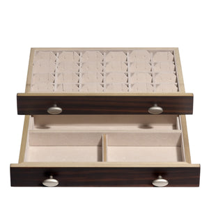 "Top drawer is a replica of the well of the jewelry box. The bottom drawer is catered to posts and studs with twenty-four 1.5"" x 1.5"" compartments with removable earring panels."