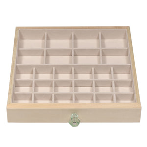 "Top drawer features eight 2 ½"" x 2 ½"" jewelry compartments."