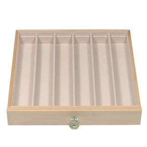 "The second jewelry drawer is optimal for pearl stands and tennis bracelets with six 10 ½"" x 1 ¾"" compartments."