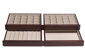 "The top and second drawers consist of twenty 2"" x 2"" squares for earrings. The third drawer caters to rings with eight ring bars, accommodating up to seven rings each. The bottom drawer is simply open for large or formed necklaces, bracelets, and brooches."
