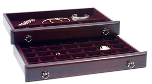 Top drawer features 35 small square compartments for earrings, brooches, and other small items. Bottom drawer serves as a catch all with one large rectangular compartment in the back, and three square compartments in the front for additional storage.