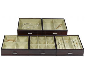 Five pull out drawers with two ring bars and seventeen jewelry compartments.