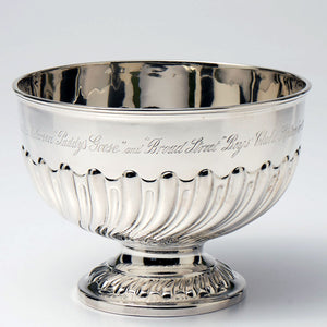 Sterling trophy bowl on a pedestal base.