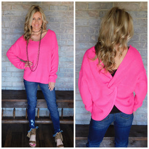 Neon pink open back light sweater