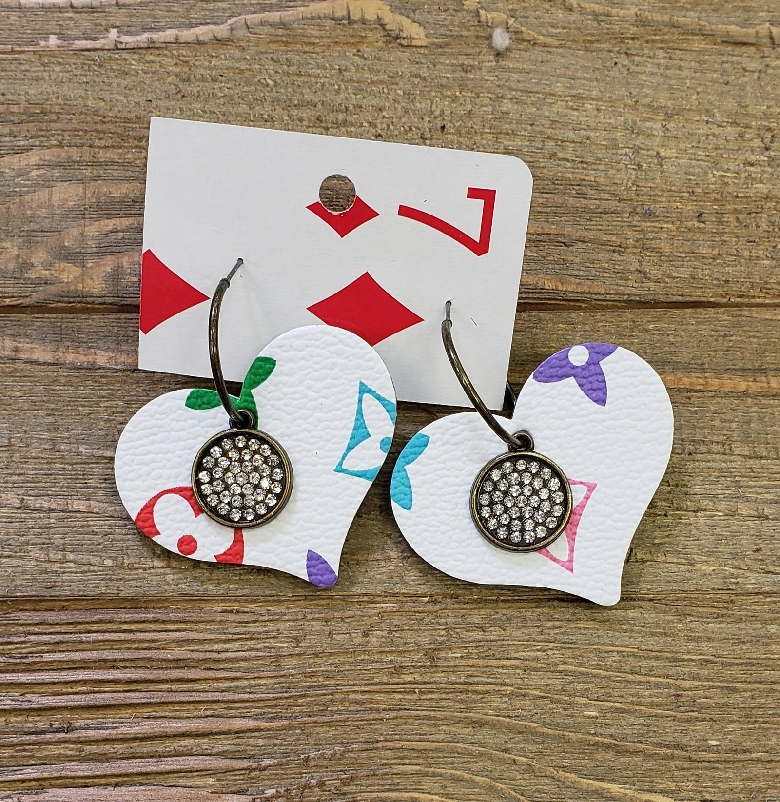 White multi color leather heart embellished earrings