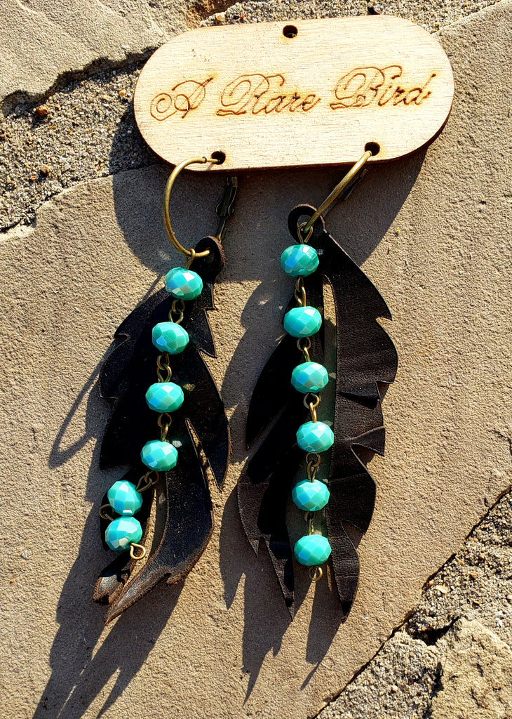 Black leather feather and turquoise beaded earrings