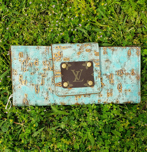 Light turquoise and gold leather wallet with LV patch