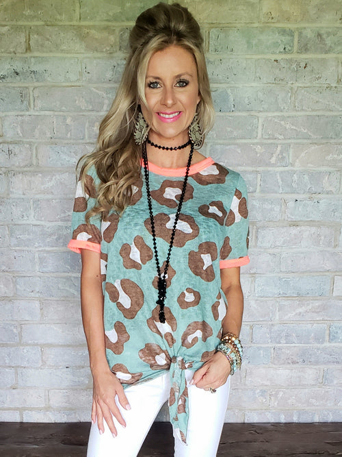 Light turquoise & neon coral leopard knotted blouse