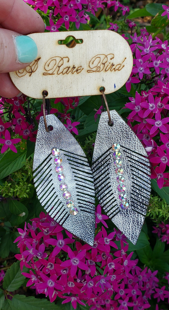 Metallic Black AB feather leather earrings by A rare bird