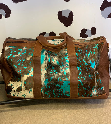 Headed West teal acid wash hair on hide & brown leather duffle