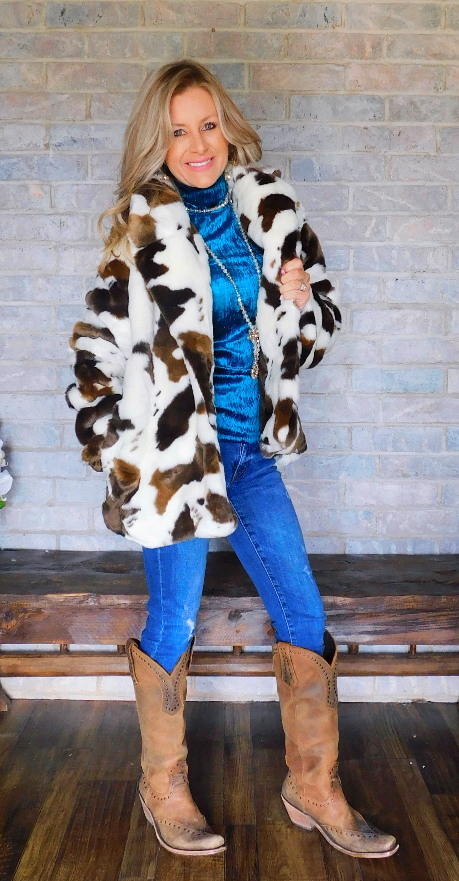 The Beth Cow Print faux fur coat