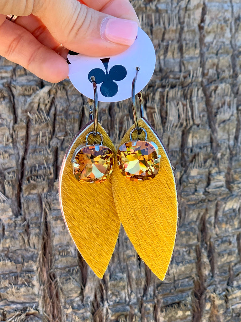 Mustard hair on hide crystal feather earrings