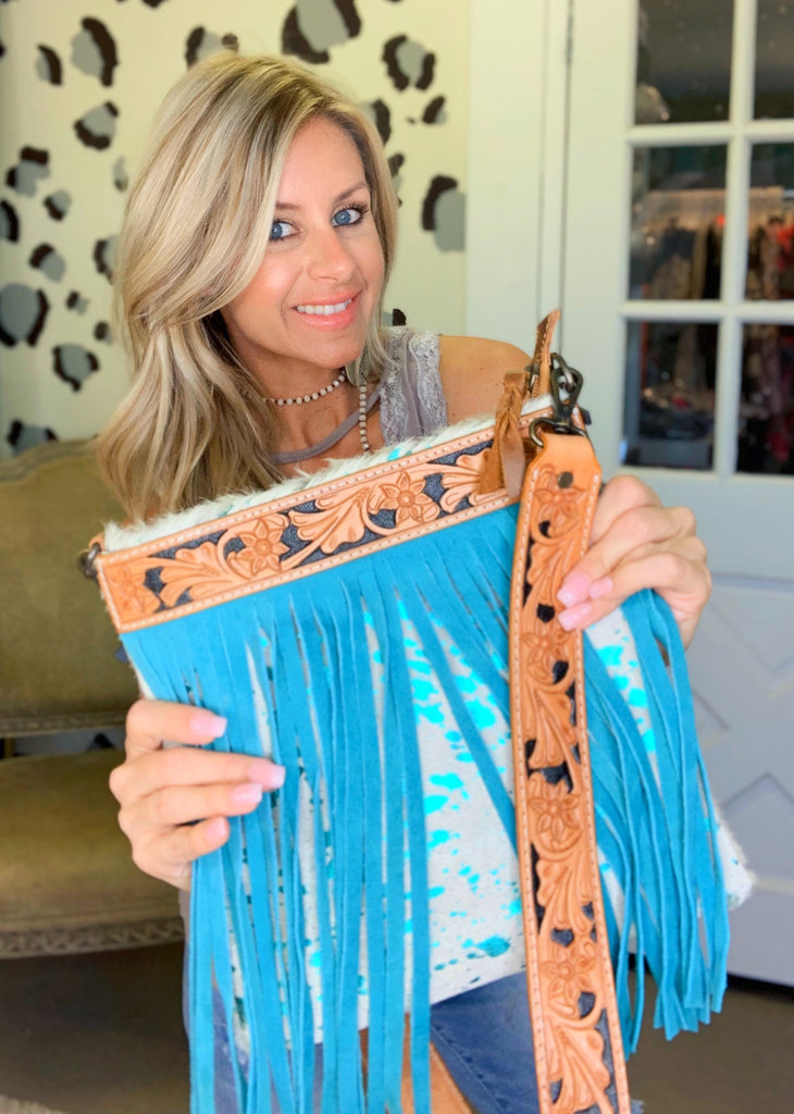 Turquoise acid wash fringe purse with tooled leather strap
