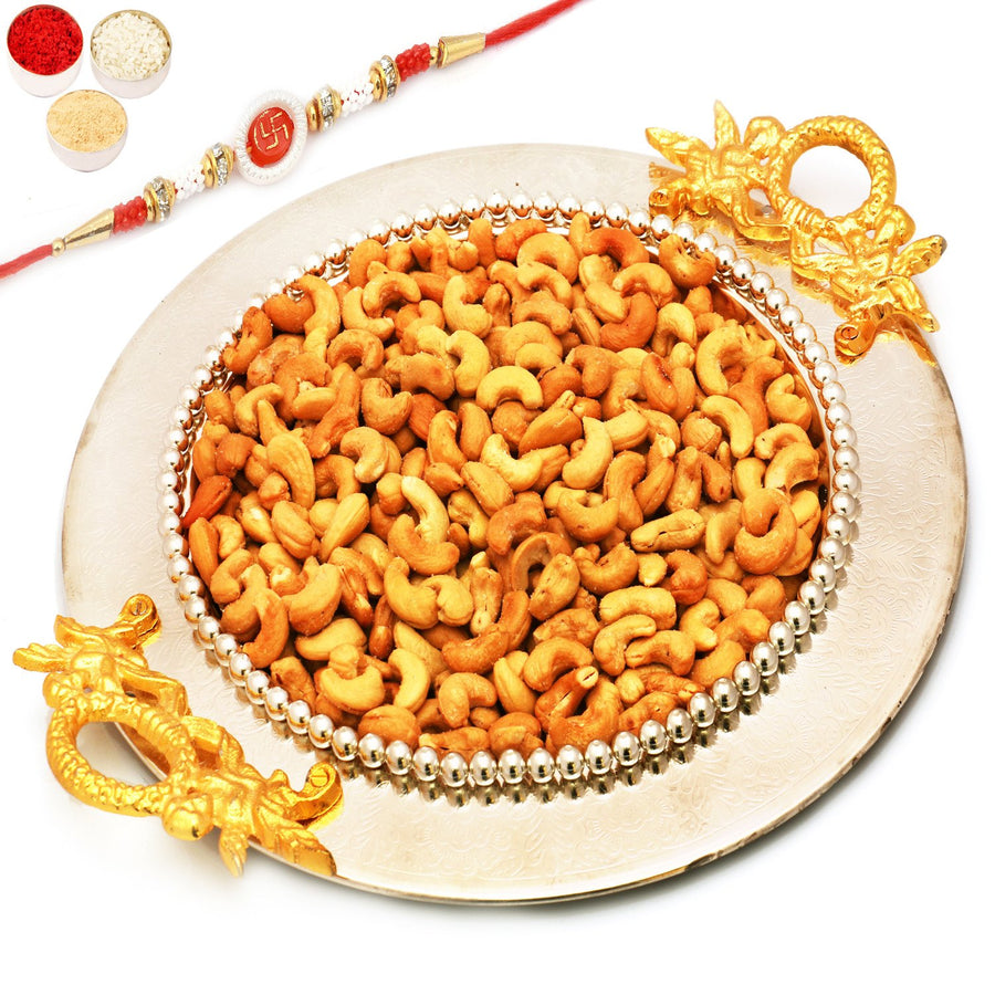 Golden Silver Round Tray with with Om Swastk Rakhi and Roasted Cashews