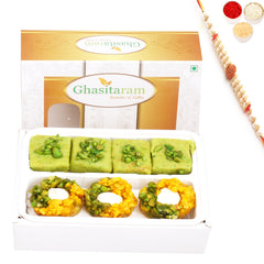 Ghasitaram Gifts Rakhi Gifts for Brother Rakhi Sweets- Assorted Box of Pista Barfi, Kesar Pista Delight, Choco Boat and Besan Barfi  200 gms with Rudraksh Rakhi