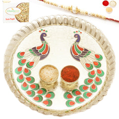 Rakhi Pooja Thalis- Peacock Pooja Thali with Pearl Rakhi with 200 gms of Soan Papdi