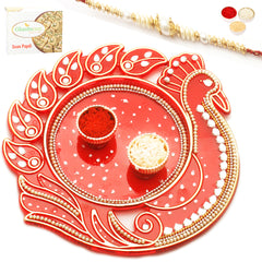 Rakhi Pooja Thalis- Red Peacock with Pearl Rakhi with 200 gms of Soan Papdi