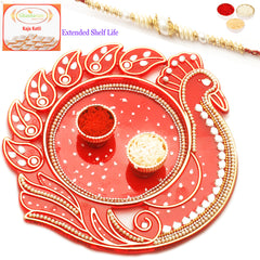 Rakhi Pooja Thalis- Red Peacock with Pearl Rakhi with 200 gms of Kaju katli