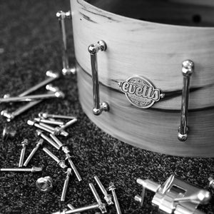 Evetts handcrafted bespoke snare drum during assembly tube lugs, trick throw off