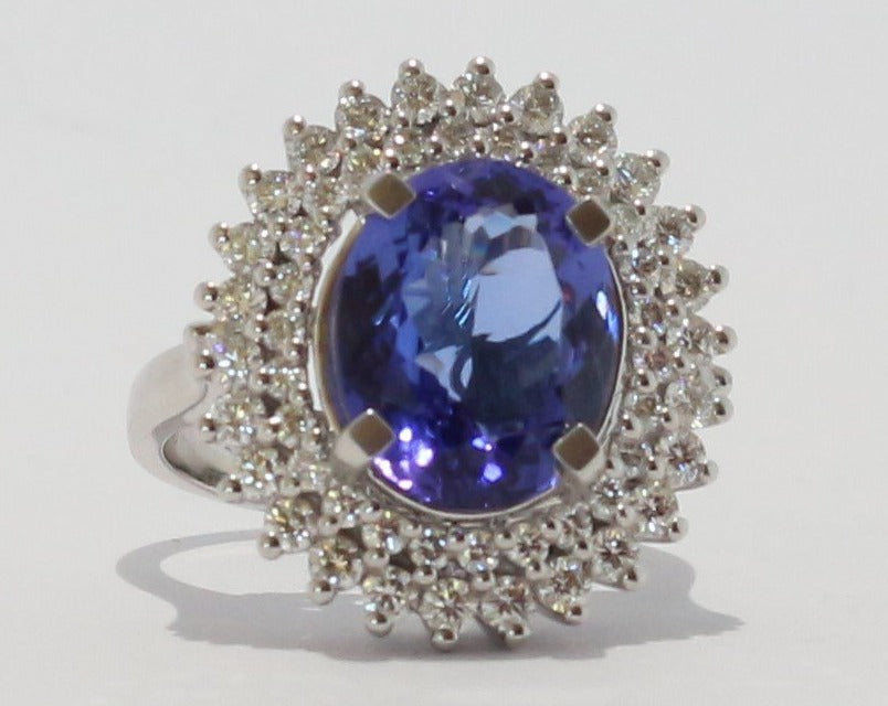18ct White gold Oval cut Tanzanite & Diamond Cluster Ring
