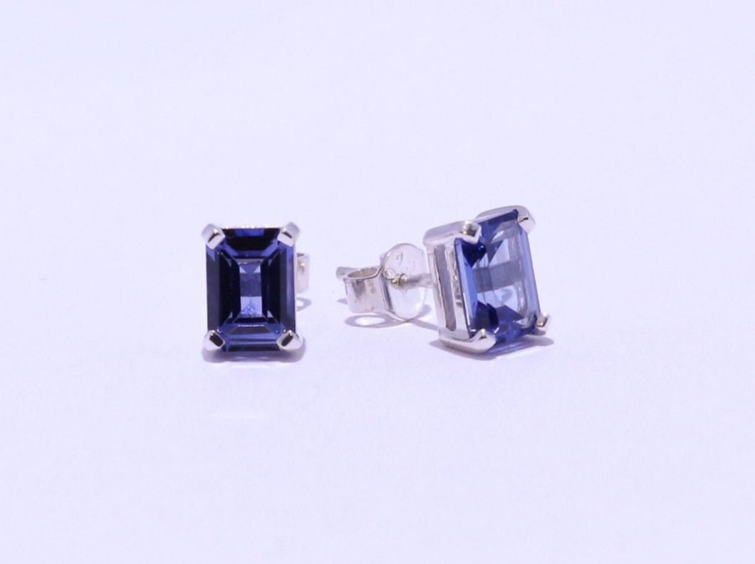 925 Synthetic Sapphire 7.7x6mm Octagon 4-claw set Stud Earrings