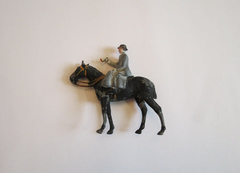 lead lady on a horse antique toys